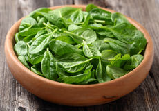 Spinach in a wooden plate Royalty Free Stock Image