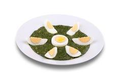 Spinaci con l'uovo bollito Fotografie Stock
