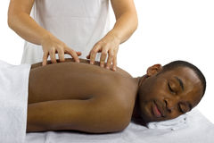 Spinal Check. Young female therapist examining male patient's spinal column Royalty Free Stock Images
