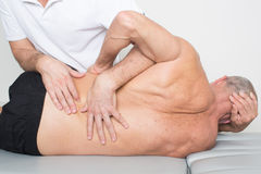 Spinal manipulation Stock Photo