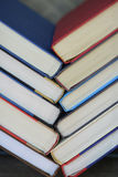 Spinal. Red, white, and blue covered books stacked in chevron pattern Stock Images