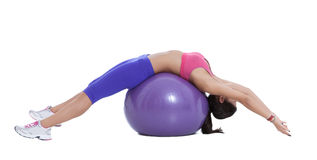 Spinal stretch on the swiss ball Stock Photos