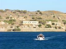 Spinalonga Boat Trip in Crete. Boat trip to Spinalonga island in Crete, Greece. View from Plaka, Elounda Royalty Free Stock Photos