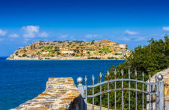 Spinalonga island at blue water of Crete, Greece. Island of Spinalonga (official name: Kalidon) is located at the eastern section of Crete, in Lasithi prefecture Royalty Free Stock Photography