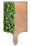 Spinat auf einem Schneidebrett Stockbild
