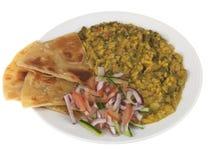 Spinat-Dal mit Salat Stockfotos