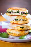 Spinat sandwich with onion closeup on wooden table. royalty free stock photos