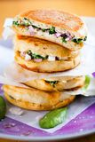Spinat sandwich with onion closeup on wooden table. stock image