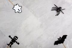 Spindel för för för för allhelgonaaftonpappersspöke, slagträ, skelett och gummi Royaltyfri Bild