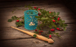 Spindle, a branch of wild rose and lantern Stock Photo