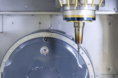 The spindle of CNC machine with the taper cutter. Royalty Free Stock Photography
