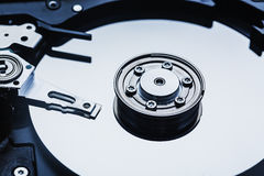 Spindle and plate open hard disk drive. Macro shot.  Royalty Free Stock Image