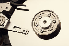 Spindle and plate open hard disk drive. Macro shot.  Stock Photo