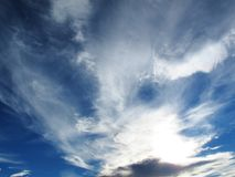 Spindrift clouds on blue sky before sunset Stock Photography