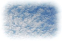 Spindrift clouds with a vignette royalty free stock images