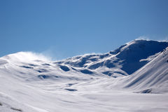 Spindrift coming off New Zealand mountains Royalty Free Stock Images