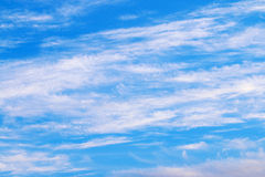 Spindrift white clouds on light blue clear sky Royalty Free Stock Image