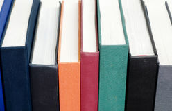 Spine of books on a shelf Stock Images