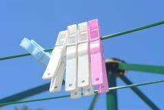 Spine di vestiti colorate Fotografia Stock Libera da Diritti