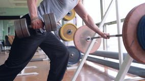 Spine workout with dumbbell stock footage