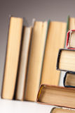 Spines of books. Macro shut of spines of books against stack of books Royalty Free Stock Images