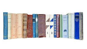 Spines of old books on a white background.  Stock Images