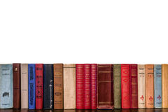 Spines of old books on a white background Royalty Free Stock Images
