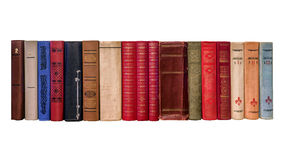 Spines of old books on a white background Stock Photos