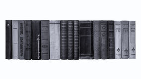 Spines of old books on a white background Stock Photo