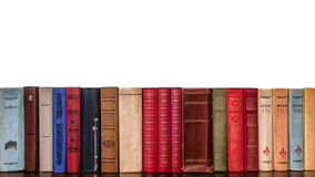 Spines of old books on a white background Royalty Free Stock Photos