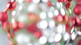Spining Christmas Bokeh with Distortion. Distorted Christmas bokeh in green red and white, spinning slowly for design element in motion graphics composition stock footage