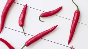 Spining in Slow Motion Red hot chili peppers pattern isolated on white
