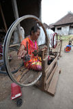 Spinn. A woman spinning yarn to be woven at his home in Sragen, Central Java, Indonesia Stock Image