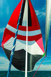Spinnaker with uphaul, blue sky in background. Spinnaker with uphaul on sail boat, blue sky in background. Marine sailing objects concept Royalty Free Stock Photos