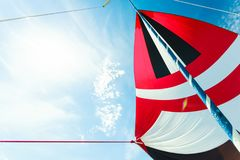 Spinnaker with uphaul, blue sky in background. Spinnaker with uphaul on sail boat, blue sky in background. Marine sailing objects concept Stock Images