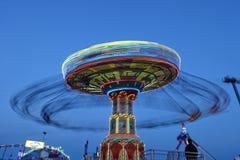 Spinnende Carrousel in de kust van Jersey Stock Foto