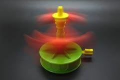 Spinnendes Spielzeug der Unterhaltung mit Bewegungsunschärfe Lizenzfreie Stockfotografie