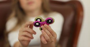 Spinner concept. little girl playing with spinners to camera. Spinner concept. little girl playing with spinners to camera Royalty Free Stock Image