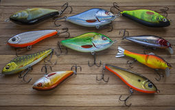 Spinner Lures And Fishing Floats on wooden desk Royalty Free Stock Images