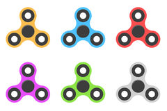 Spinner. A modern anti-stress toy in a flat style. A toy for hands and fingers. Bearing system. Set of multi-colored spinners isol Stock Images