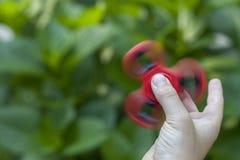 Spinner seine Hand Stockfoto