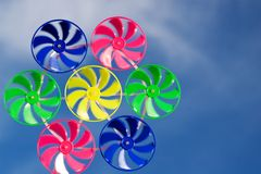 Spinner toy. Wind spinned  spinner toy on blue sky background Royalty Free Stock Photo