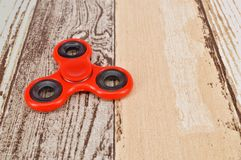 Spinner on wooden background Stock Photography
