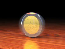 Spinning 2 Euro coin. Spinning 2 Euro coin on a wooden desk Royalty Free Stock Image