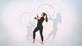 Spinning acrobat beautiful hula hoops in slow motion stock video footage