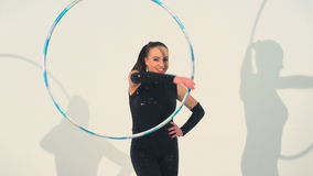 Spinning acrobat beautiful hula hoops in slow motion stock footage