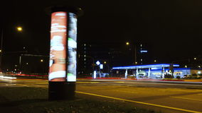 Spinning advertising pillar - time lapse stock video footage
