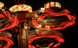 Spinning Amusement At Night Stock Photography