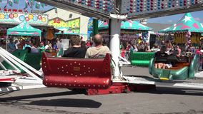 Spinning, Amusement Park Rides, Fun, Leisure. Stock video of spinning rides stock video footage