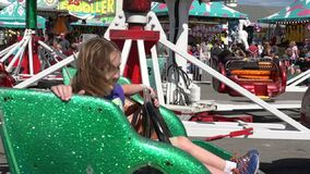 Spinning, Amusement Park Rides, Fun, Leisure. Stock video of spinning rides. Girl with long blonde hair stock video